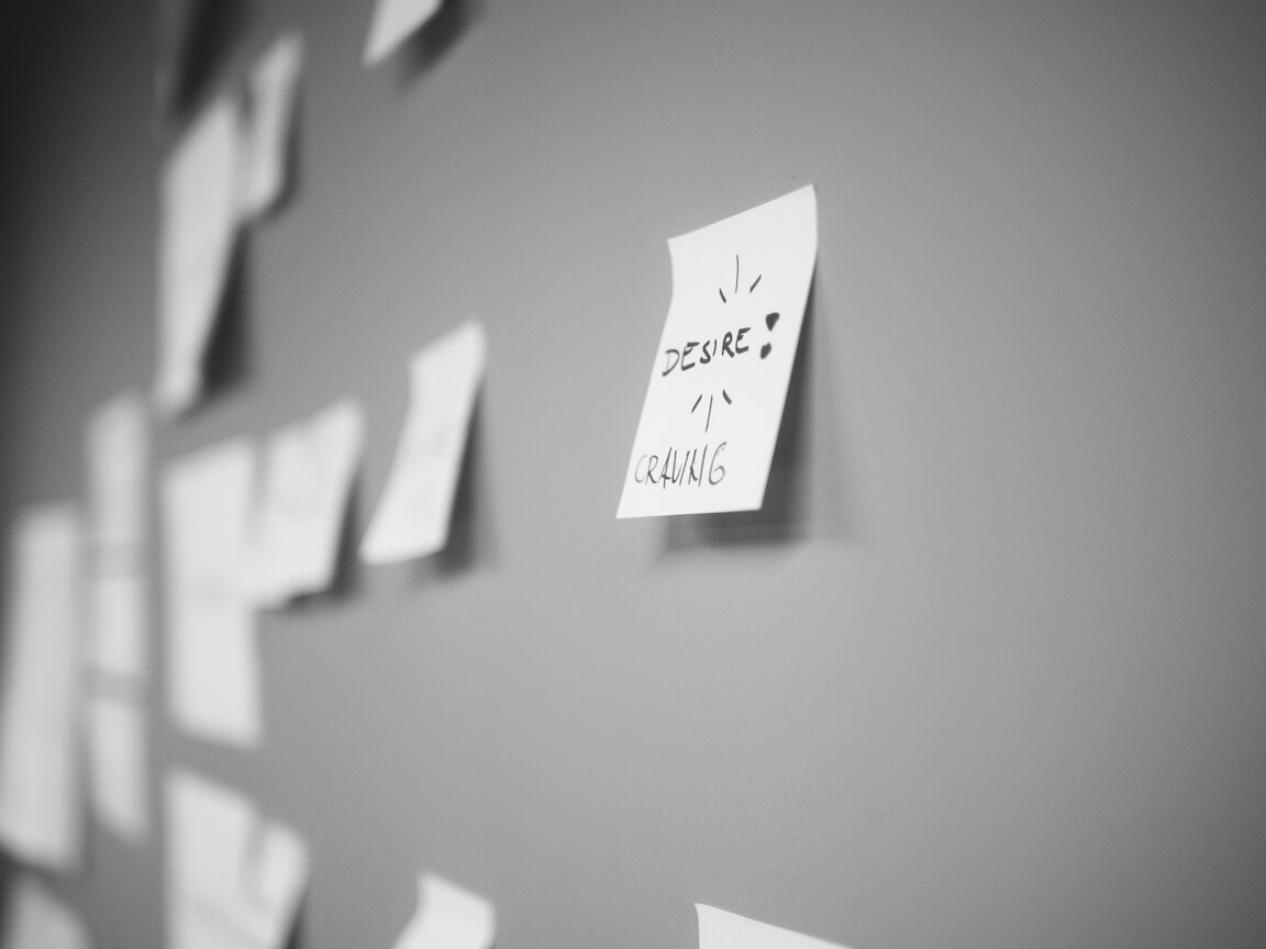 Black and white image of post-it notes during design thinking workshop